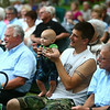 8-6-14<br /> Barbershop Harmony Festival<br /> Paul Dorisse holds his son Chandler and bounces him up and down to the music from the Barbershop Harmony Festival in Highland Park on Wednesday.<br /> Kelly Lafferty | Kokomo Tribune