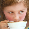 8-2-14<br /> Medieval Festival benefiting Day of CHANGE<br /> Allyson Hatt, 6, takes a sip of the tea with the queen in Foster Park on Saturday afternoon during the Medieval Festival, benefiting Day of CHANGE.<br /> Kelly Lafferty | Kokomo Tribune