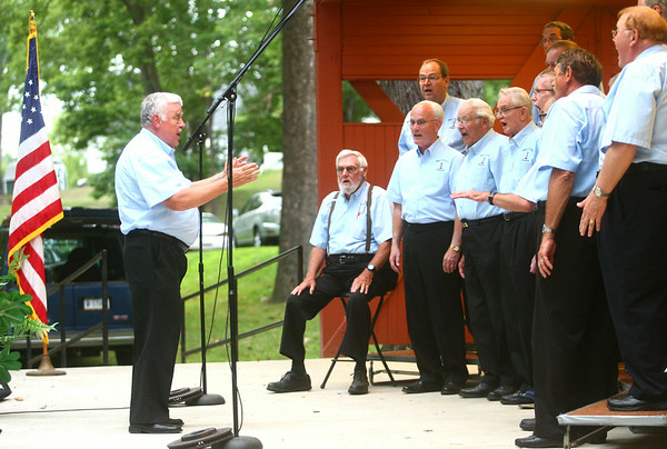 8-6-14<br /> Barbershop Harmony Festival<br /> Charlie Rose directs the Kokomo Men of Note Chorus on Wednesday evening in Highland Park during the Barbershop Harmony Festival.<br /> Kelly Lafferty | Kokomo Tribune