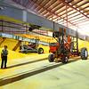 "8-1-14<br /> Clerance ""Hoppy"" Trueman guides the driver of a conveyor into position inside the massive 5 million bushel warehouse at Kokomo Grain<br /> Tim Bath | Kokomo Tribune"