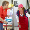 8-1-14<br /> Whites Meat Market<br /> Susan Robinson shows Sherri Lindberg different types of cheeses available at White's Meat Market.<br /> Kelly Lafferty | Kokomo Tribune