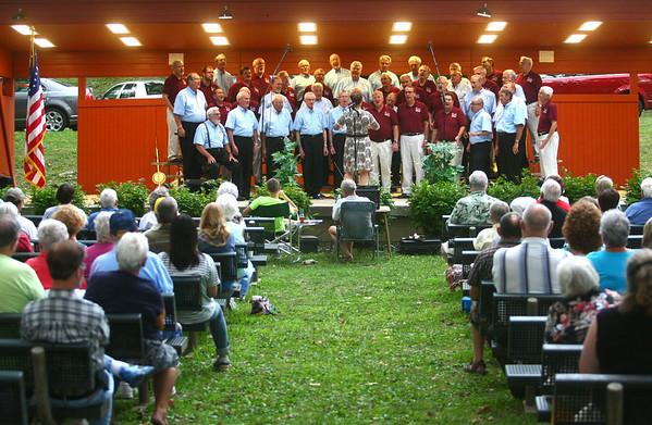 8-6-14<br /> Barbershop Harmony Festival<br /> The Kokomo Men of Note Chorus sings with The Tippecanotes Chorus in Highland Park on Wednesday evening during the Barbershop Harmony Festival.<br /> Kelly Lafferty | Kokomo Tribune