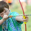 8-2-14<br /> Medieval Festival benefiting Day of CHANGE<br /> Carter Unrein, 11, aims the bow and arrow at the target on the dunk tank in Foster Park during the Medieval Festival benefiting Day of CHANGE on Saturday.<br /> Kelly Lafferty | Kokomo Tribune