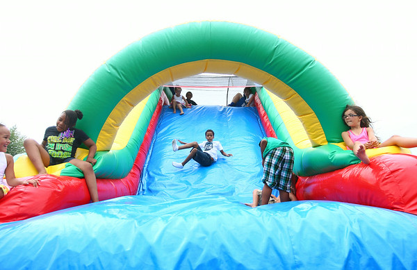 8-9-14<br /> Mo Boy Summer Fest<br /> Kids play on the bounce house in Studebaker Park during the Mo Boy Summer Fest.<br /> Kelly Lafferty | Kokomo Tribune