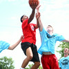 8-9-14<br /> Mo Boy Summer Fest<br /> Brandon Wood goes up for a basket against Erik Bowen during the Mo Boy Summer Fest basketball tournament at Studebaker Park.<br /> Kelly Lafferty | Kokomo Tribune