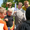8-2-14<br /> Medieval Festival benefiting Day of CHANGE<br /> A group circles around one of the members of the Empire of Chivalry and Steel to listen to instructions on the padded fighting form during the Medieval Festival in Foster Park.<br /> Kelly Lafferty | Kokomo Tribune