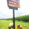 8-11-14<br /> Workers from Michiana Contracting Inc. out of Plymouth, Indiana, installing signs throughout the city. Nick Lunetta and David Sills finish up the mounting of the sign with a decorative base.<br /> Tim Bath | Kokomo Tribune