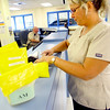 7-9-14 <br /> Nurse Kristie Shirley checks a set of meds before they are given to an inmate at the Howard County Criminal Justic Center.<br /> Tim Bath | Kokomo Tribune