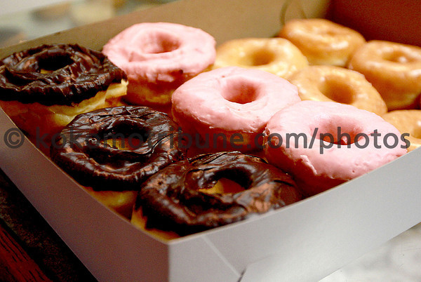 9-22-12<br /> Dan's Donuts at 1 AM<br /> Two dozen donuts at Dan's Donuts are placed in a box for the customer.<br /> KT photo | Kelly Lafferty