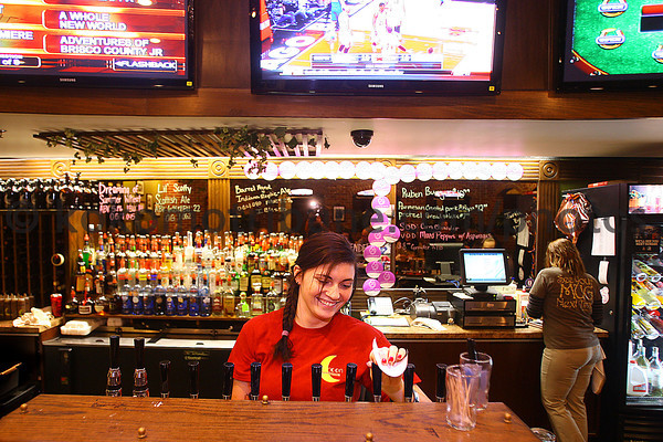 1-24-14   --- Half Moon Restaurant and Brewery. Heather Martin fills a glass with their brew.-- <br />   KT photo | Tim Bath
