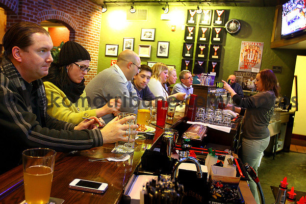 1-24-14   --- Half Moon Restaurant and Brewery. Jimmy DuBois and Christa Pokrzywa sit at the bar. -- <br />   KT photo | Tim Bath