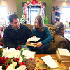 Out and About<br /> Jonathan Coppock and Christina Miller look over their wedding invitations at Bowden Flowers<br /> KT photo | Kelly Lafferty