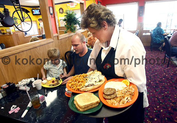 6-6-08<br /> Frittatas Restaurant at Espanol and Lafountain Sts.<br /> Waitress Kathy Wilson delivers the fair to Lucas, 5, and dad Jason Campbell.<br /> KT photo | Tim Bath