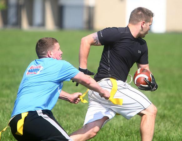 5-17-14<br /> Buddy Bowl<br /> Dustin Delong goes after Jeff Navarre's flag during the Buddy Bowl flag football game at Northwestern on Saturday morning.<br /> Kelly Lafferty | Kokomo Tribune