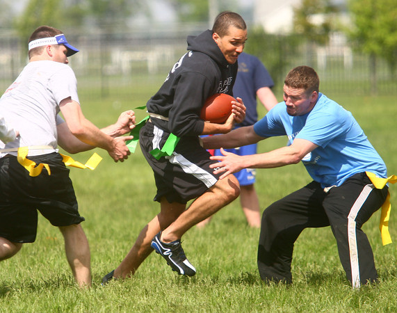 5-17-14<br /> Buddy Bowl<br /> Cameron Hinton tries to get away from Tim Nei and Dustin Delong as he runs the ball during one of the Buddy Bowl flag football games on Saturday morning.<br /> Kelly Lafferty | Kokomo Tribune