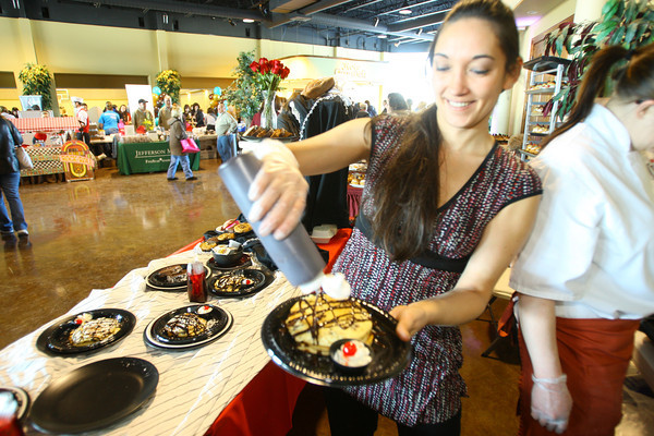 2-8-14   ---  Lois Erikson from Bob Evans drizzles chocolate syrup on chocolate chip pancakes at the Samaratian Caregivers' Chocolate Celebration. -- <br />   KT photo | Tim Bath