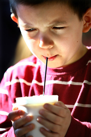 2-8-14   ---  John Indrutz, 3, sipping his hot chocolate at Samaratian Caregivers' Chocolate Celebration. -- <br />   KT photo | Tim Bath