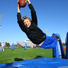 4-23-14   --- Colts' Play60 visit to Taylor Schools for a day of physical activities. Quinten Tucker dives for a ball during one of the drills. -- <br />   Tim Bath | Kokomo Tribune