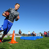 4-23-14   --- Colts' Play60 visit to Taylor Schools for a day of physical activities. Kaden Law runs an obstacle set up by the coaches and trainers for the Colts'.-- <br />   Tim Bath | Kokomo Tribune