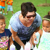 6-25-14<br /> Craft Fest<br /> Kandy Renfro (center) compliments Anaya Beets (left) and Renfro's grandaughter Alanna Tyson on the sand art they made during the Craft Fest at Highland Park on Wednesday.<br /> Kelly Lafferty | Kokomo Tribune
