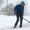 12-26-12<br /> Kokomo snow<br /> Doris Moss shovels snow off the sidewalk on Defenbaugh at Washington on Wednesday morning.<br /> KT photo | Kelly Lafferty