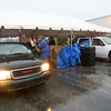 12-20-12<br /> Rescue Mission annual Christmas food and gift delivery starting at GM Holdings.<br /> KT photo | Tim Bath