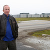 12-19-12<br /> Gov. Mitch Daniels<br /> Gov. Mitch Daniels stands in front of what will be the new Chrysler plant in Tipton County on Wednesday morning.<br /> KT photo | Kelly Lafferty