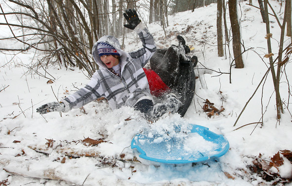 12-26-12<br /> Kokomo snow<br /> Alex Nelson falls into the snow as his sled flips at Highland Park on Wednesday.<br /> KT photo   Kelly Lafferty