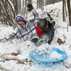 12-26-12<br /> Kokomo snow<br /> Alex Nelson falls into the snow as his sled flips at Highland Park on Wednesday.<br /> KT photo | Kelly Lafferty