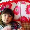 12-27-12<br /> Little Pink Rose<br /> Ava Rhees, one of Jennie's daughters, wears a fashion hair clip her mom crafted for her to match her outfit, as she holds an umbrella she got for Christmas.<br /> KT photo | Kelly Lafferty