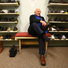 12-19-12<br /> Williams Shoes<br /> Cecil Scott of Tipton puts his shoes back on after trying on pairs of shoes at Williams Shoes on Wednesday.<br /> KT photo | Kelly Lafferty