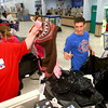 12-17-12<br /> Goodfellows shopping at Meijer store on Monday evening. Meijer employee Melissa Duncan hands stuff to KHS wrestlers Christian Hall and Fletcher Miller who are volunteering their time to help along with other wrestlers and cheerleaders.<br /> KT photo | Tim Bath