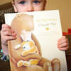 12-24-12<br /> Emily White's son Greyson is holding a book that dad recorded for the kids. Dad is serving in the military and will not be home for Christmas.<br /> KT photo | Tim Bath