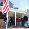 12-22-12<br /> Walton house dedication<br /> Members of the Walton and Browning families stand on the front porch as Kokomo's VFW chapter raise the American flag and a military flag in front of the Walton family's new home on Saturday.<br /> KT photo | Kelly Lafferty