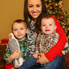 12-24-12<br /> Emily White with her kids Greyson, 2, and Brennon, 9 months. Greyson is holding a doll with dad's photo on it. Dad is serving in the military and will not be home for Christmas.<br /> KT photo | Tim Bath