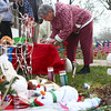 12-19-12<br /> Sandy Hook memorial<br /> Carol Record signs her name in the guest book after bringing a stuffed animal bear to a Kokomo memorial for the victims of the Sandy Hook Elementary School shooting.<br /> KT photo | Kelly Lafferty