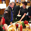 12-19-12<br /> Gov. Mitch Daniels<br /> Debbie Sherrill delivers Gov. Mitch Daniel's breakfast to him on Wednesday morning when he stopped at Sherrill's Restaurant in Tipton.<br /> KT photo | Kelly Lafferty