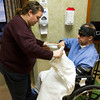 12-31-12<br /> Walton rehab<br /> Rhonda Walton puts a blanket on her husband, Anthony, before they go downstairs at the VA Hospital in Indianapolis. Although Anthony can walk, it is hospital policy that he has to be transported via wheelchair.<br /> KT photo | Kelly Lafferty