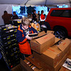 12-20-13   ---  The Rescue Missions Red Ribbon Christmas food and gift delivery. Hundreds of volunteers loaded and delivered trucks and vans full of gift boxes.<br />   KT photo | Tim Bath