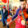 12-7-13   ---  Austin McMillan plays the violin while soliciting donations at the Salvation Arm Kettle at Krogers on North Dixon Road. He has worked the kettle before but this is the first time he has played for donations.<br />   KT photo | Tim Bath
