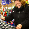 12-17-13   ---  Goodfellows shopping at Meijer on Tuesday evening. Ashley Norris looking at a dress shirt for her son.<br />   KT photo | Tim Bath