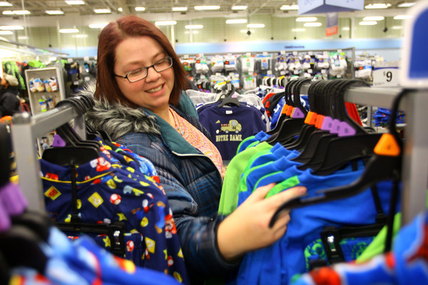 12-17-13   ---  Goodfellows shopping at Meijer on Tuesday evening. Kin Kochert searching through pajamas for her kids.<br />   KT photo | Tim Bath