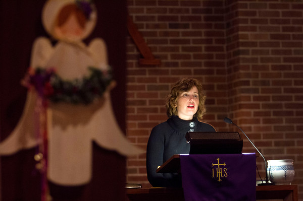 12-12-13<br /> Southside Christian Church's Blue Christmas service<br /> Reverend Rebecca Sundquist preaches during the Blue Christmas Service at Southside Christian Church on Wednesday.<br /> KT photo | Kelly Lafferty