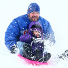 12-14-13<br /> Jackson Morrow Park snow<br /> Isabella Sargent sleds down the hill at Jackson Morrow Park with her dad, Mike Sargent, on Saturday.<br /> KT photo | Kelly Lafferty