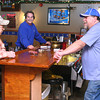 12-5-13<br /> Communities in Denver, Indiana<br /> From left: Jim Lamb, Bart Sanders, and Jeff Swanson talk together at the bar of Denver Tavern in Denver, Ind.<br /> KT photo | Kelly Lafferty