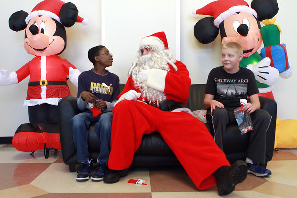 12-18-13<br /> Western's Christmas Party <br /> Santa talks to Western Middle School student Antawaun Scott (left) as Justin Yazel, also of Western Middle School, watches.<br /> KT photo | Kelly Lafferty