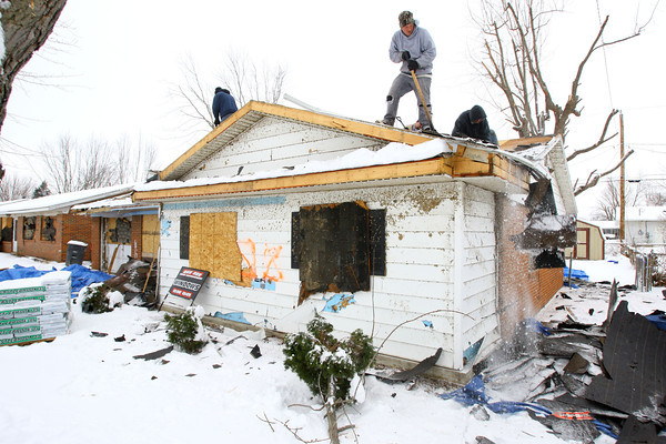 12-16-13   ---  A crew from BeeBee Home Inprovement tear off the old damaged roof to replace it at 1608 Meadowbrook Drive after the tornado heavily damaged the house. <br />   KT photo | Tim Bath