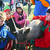 12-7-13<br /> Santa Downtown Kokomo<br /> Ian, Collin, and Brooke Wilson pet a reindeer that one of Santa's elves brought to Kokomo on Saturday afternoon.<br /> KT photo | Kelly Lafferty