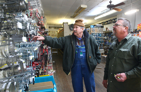 12-5-13<br /> Communities in Denver, Indiana<br /> Glenn Stevens (left) of The Denver Hardware store helps Eddie Hannah search for something he needs.<br /> KT photo | Kelly Lafferty