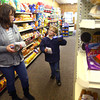 12-5-13<br /> Communities in Denver, Indiana<br /> Dolan Blakely smiles at his mom Amy Blakley after she agrees to buy Oreos at Hagan's Grocery in Denver, Ind.<br /> KT photo | Kelly Lafferty
